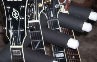 support kepala gitar dengan selubung sepon