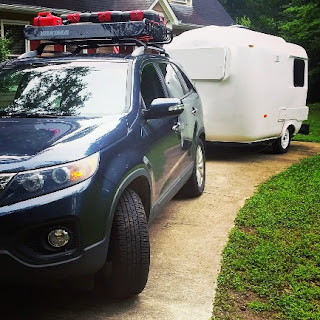 Our U-haul CT-13 fiberglass camper and 2011 Kia Sorento loaded up to head out on our epic adventure.