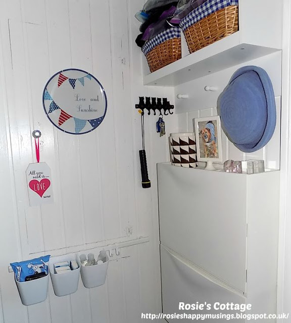 Ikea sunnersta rail & tubs in our small entryway/mudroom are perfect for storing items which might be needed as we go out.