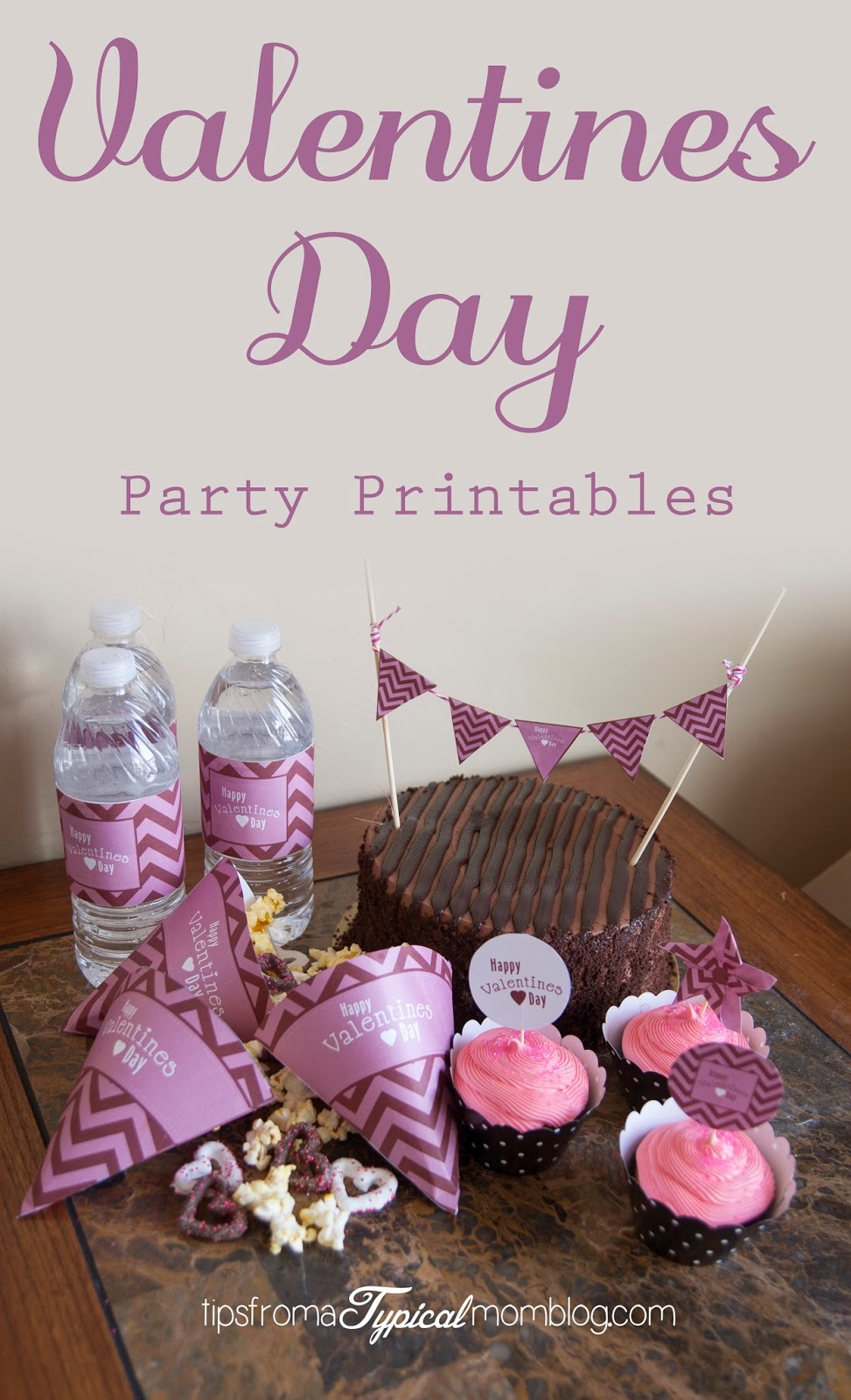 Free Valentines Day Chevron Party Printables from Tips From a Typical Mom Blog. These include, cupcake toppers, water bottle labels, treat cones and a cake banner.