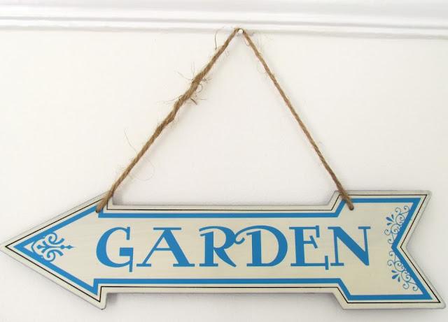 Tin garden sign