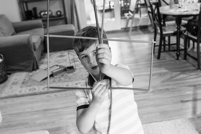 Boy looking through straw contruction ©Diana Sherblom