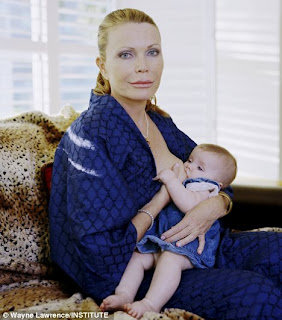 Image: First time mother: Fiona Palin, 49, who tried, unsuccessfully, to conceive for a decade, breastfeeds five-month-old daughter Kiki