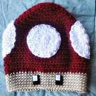 http://www.ravelry.com/patterns/library/mario-mushroom-hat-2