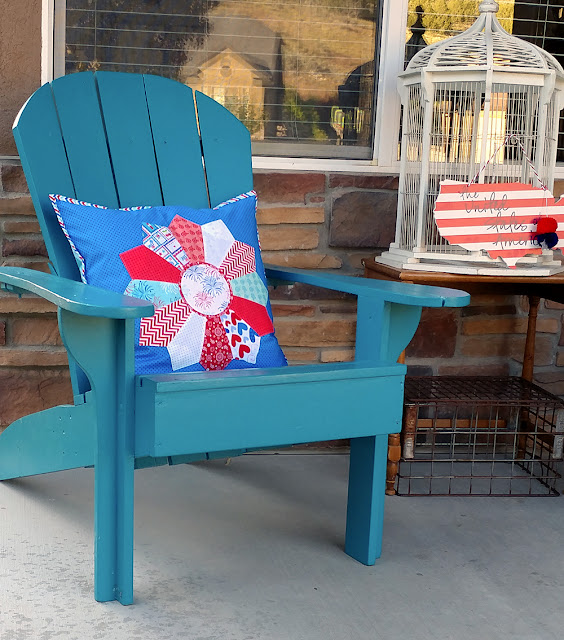 patriotic dresden pillow on front porch