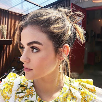 Lucy Hale hairstyle knot updo and floral yellow top