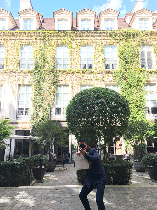 snapping a photo in Le Marais