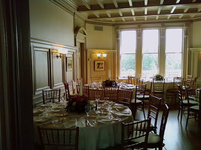 Reception tables at the Cairnwood Estate with flowers by Stein Your Florist Co.