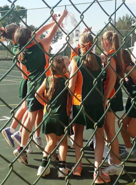Netball U/10 D girls - see only backs of team