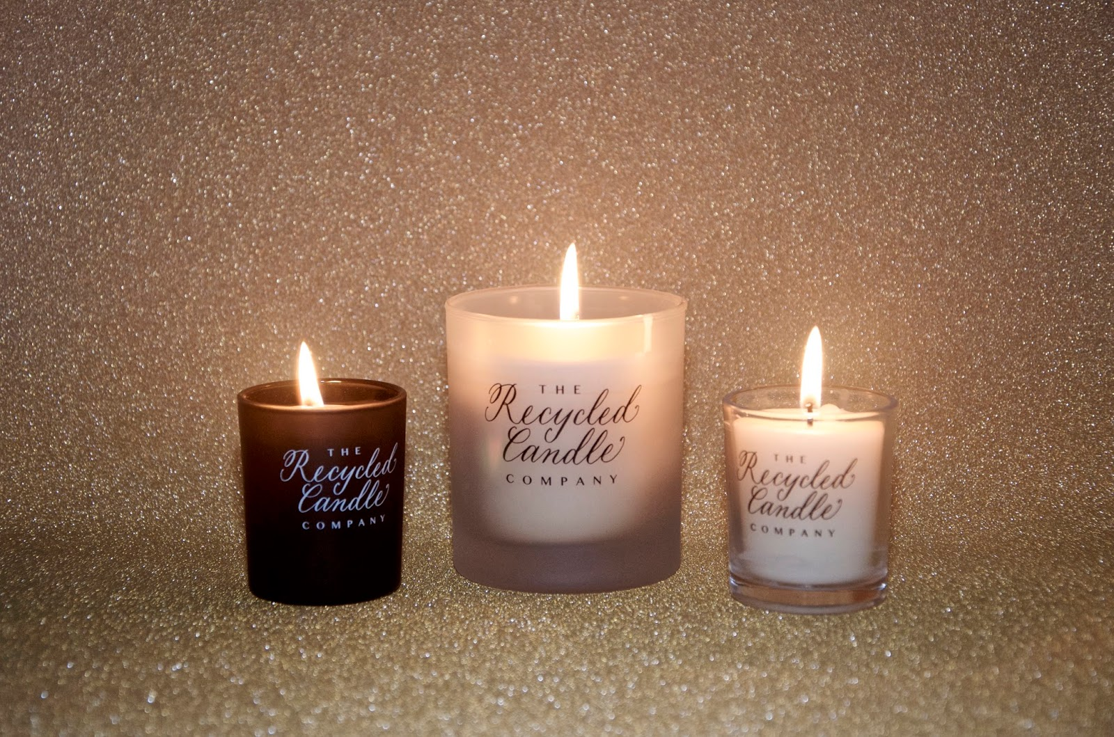 3 candles on a gold glitter background