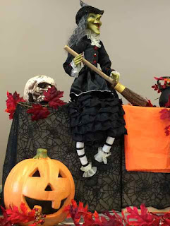 Halloween decorations with wicth and pumking.