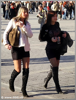 Girls walking in high heels on the street