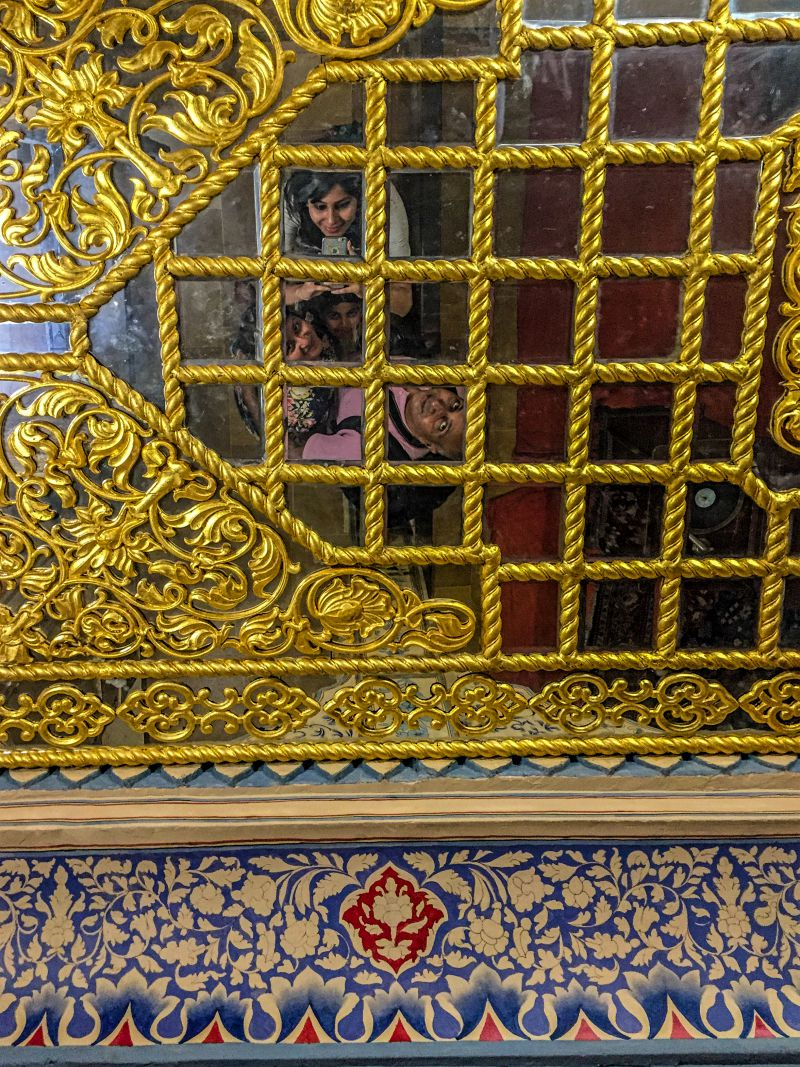 A beautiful roof with gold and mirror work.