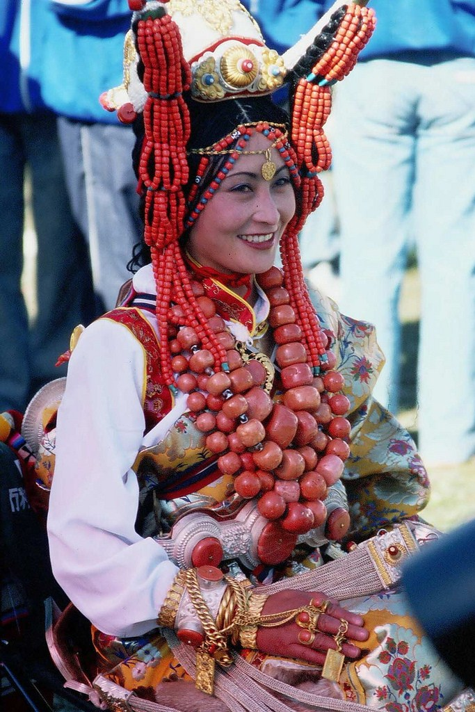 Kham region woman wearing traditional costume and jewelry