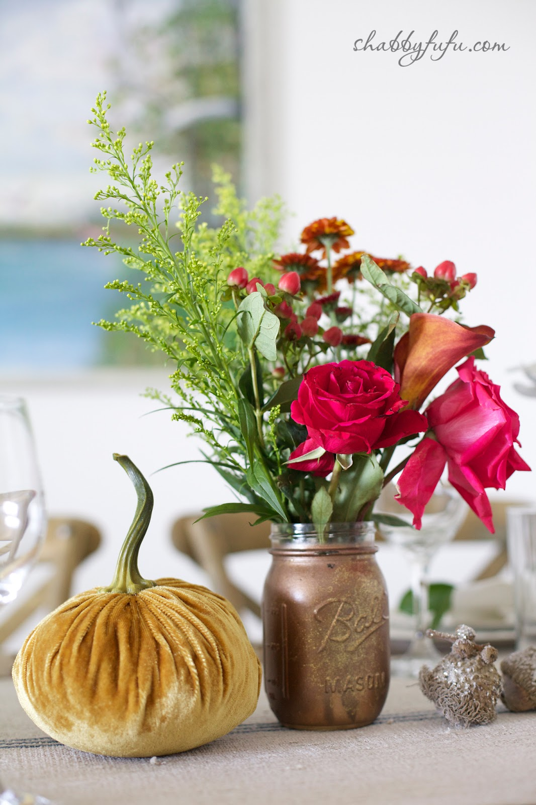 Thanksgiving Beach House decor - tablescape centerpieces with bright fall flowers and velvet pumpkins