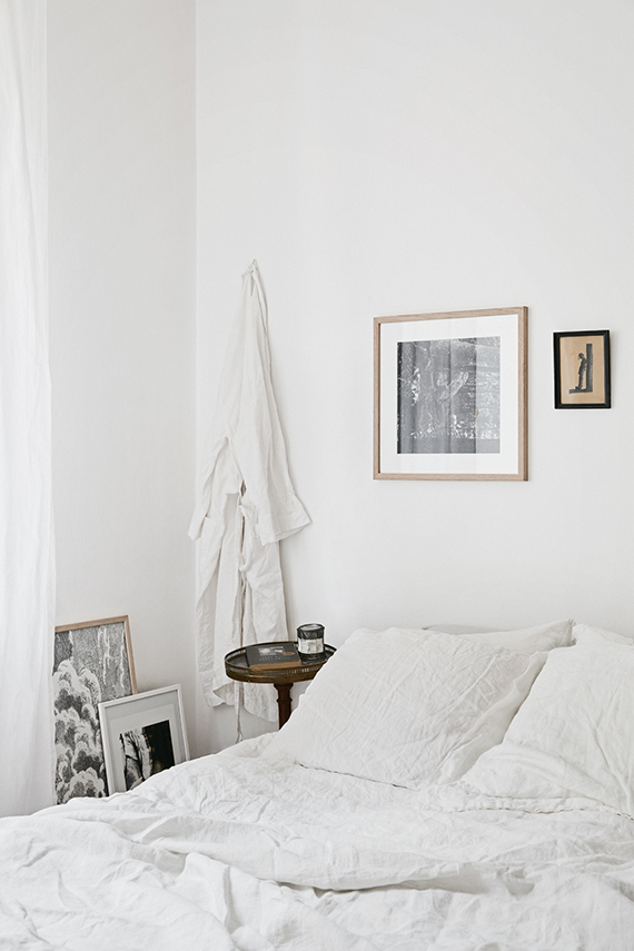 White scandinavian bedroom with linen bedding via Fantastic Frank