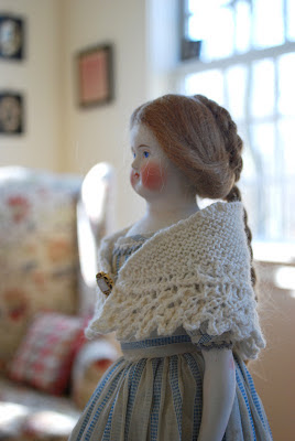 china doll with hand knit shawl