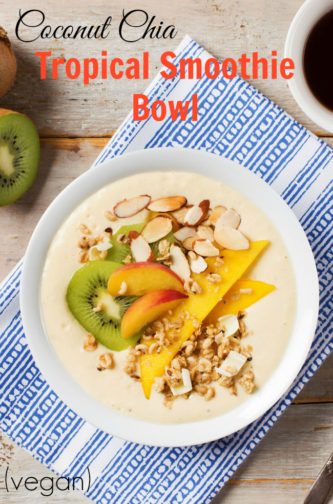 Coconut Chia Tropical Smoothie Bowl - a simple, healthy recipe using vegan yogurt, fruit & delicious toppings like coconut chia granola #vegan #recipe #smoothiebowl #breakfast #snack