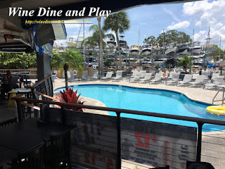 An outdoor pool next to the terrance and bar at the Ozona Blue Grill in Palm Harbor, Florida