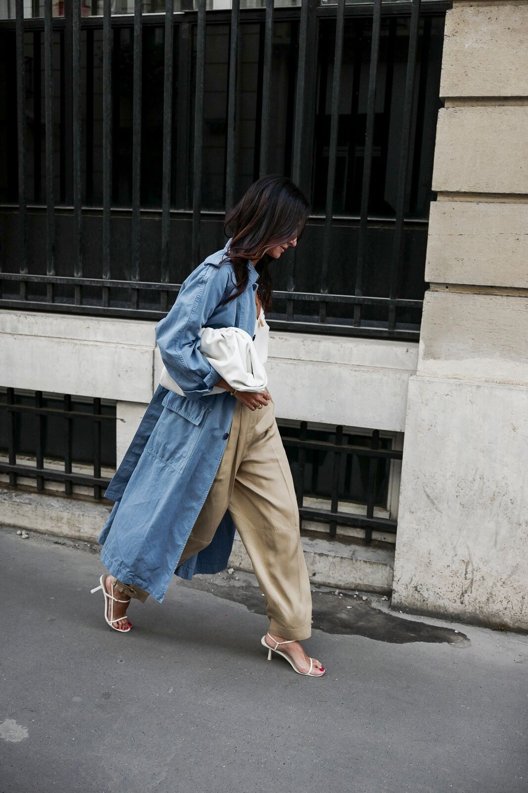 Spring Outfit Idea — Denim Trench Coat, White Cami Top, Khaki Panta, Bottega Veneta Pouch Bag, and The Row Kitten Heel Sandals