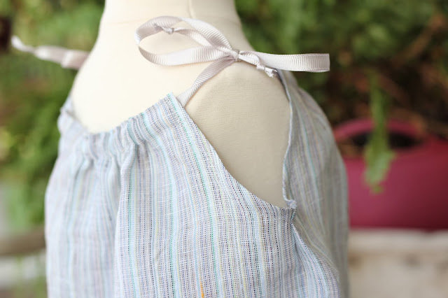 Simplicity 1813 using stripe linen from Mood Fabrics for the top and special touches with the Pfaff Creative Icon