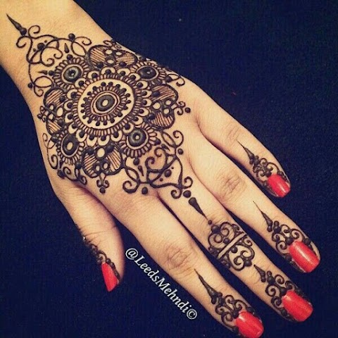 Beautiful Henna(Mehedi) design on hand for EID and other special Festivals