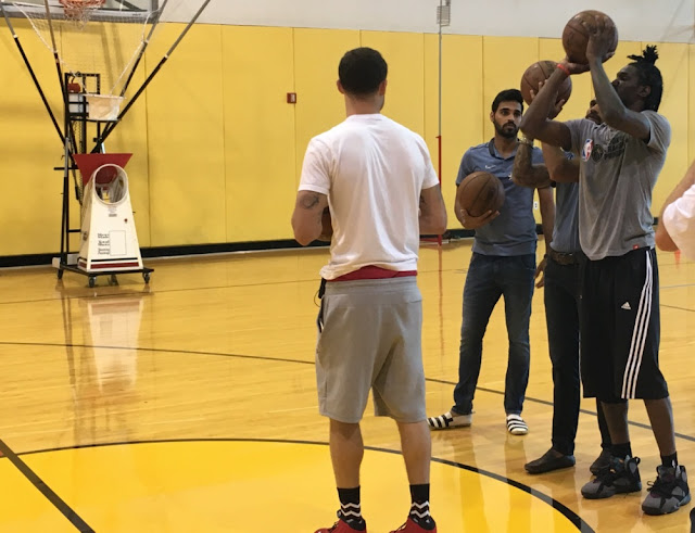 Picture 4: Shikar Dhawan and Bhuvaneshwar Kumar trying some basketball skills with Briante Weber and Tyler Johnson