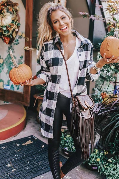 25+ Chilly Fall Outfits That Are Chic and Easy | V Neck Tee + Leather Leggings + Mules