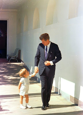 President John F. Kennedy with his son, John Jr., as they hold hands outside the White House in Washington on October 10, 1963.