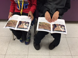 2 kids reading books