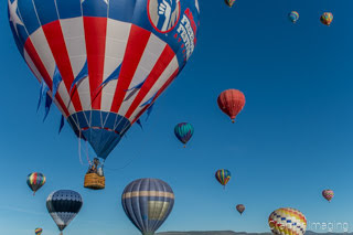 Cramer Imaging's fine art photograph of several hot air balloons taking flight in Panguitch Utah with a blue morning sky
