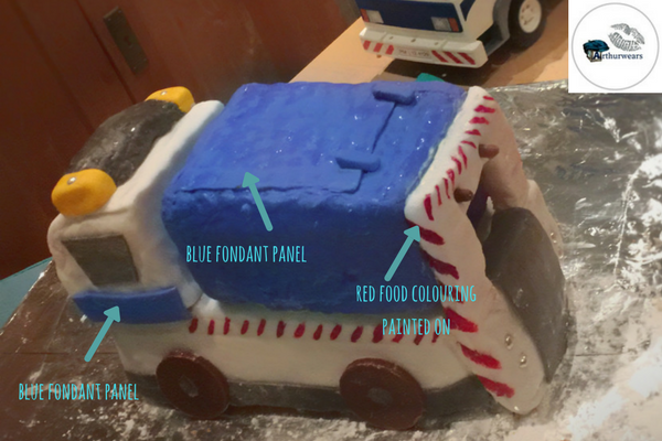 adding the warning stripes to make the blue bin lorry recycling garbage truck birthday cake