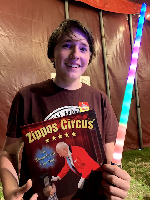 Teenager wirth Zippos Circus programme and lightsaber