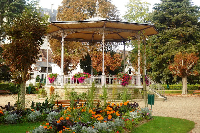 Bandstand with flowers surrounding it at Loches public park