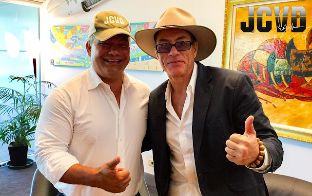 Jean-Claude Van Damme and  Mayor Tom Tate swapped hats!
