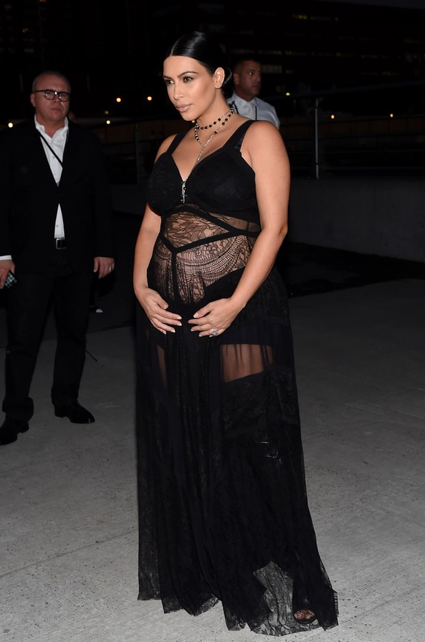 Kim Kardashian pregnant, uses transparent dress during fashion event