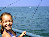 Teenage camper fishing off the Santa Monica Pier