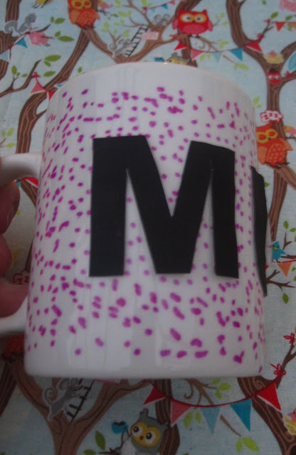 Mug being decorating around the lettering