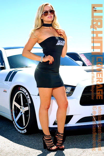 model Lisa Lee Marie in a black mini dress with strappy sandal at V8Builds car show
