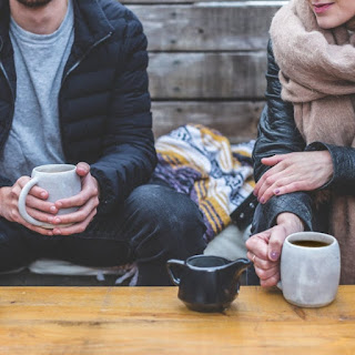 man and woman having coffee or tea together - codependent