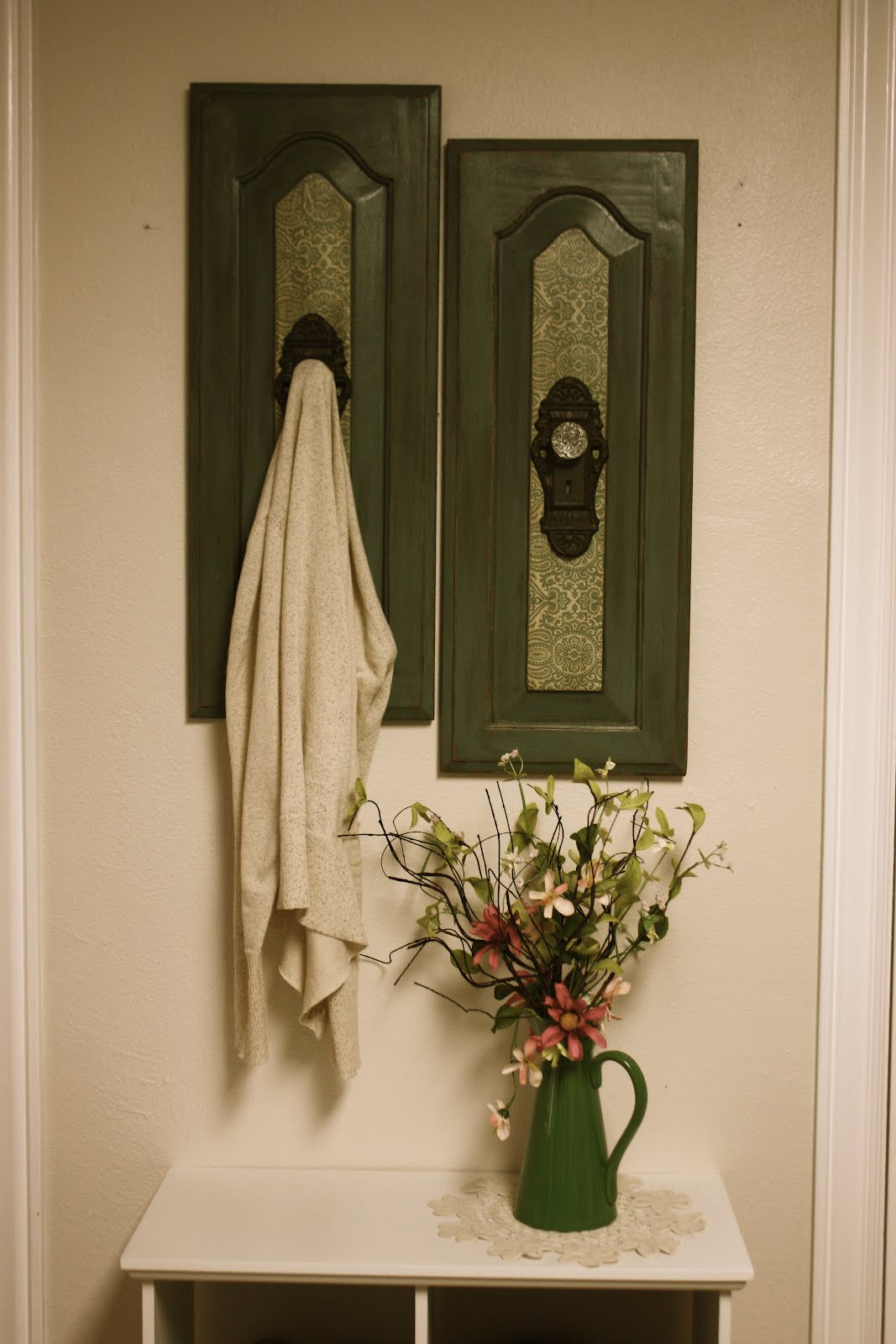 At Home Green Wall Hanging With Antique Door Knob