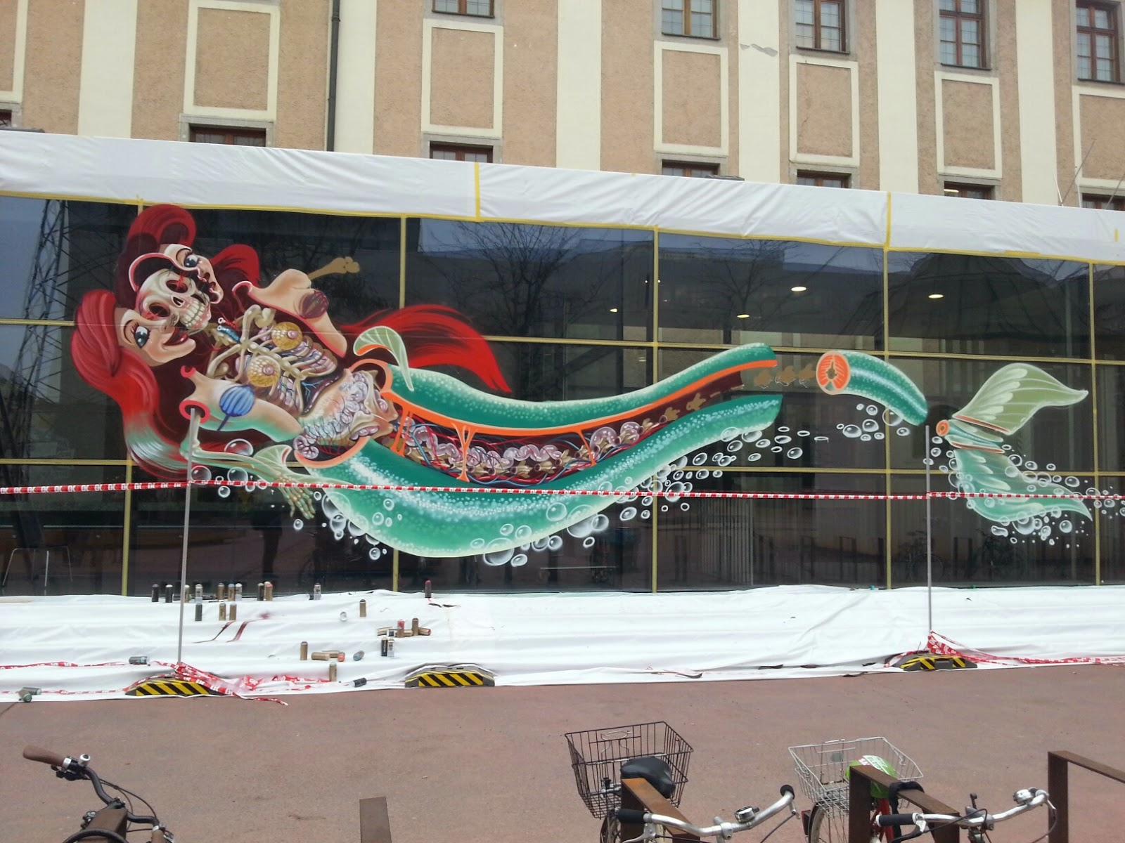 """While we last heard from him last month with Buff Monster for POW! WOW! (covered), Nychos is now back in Austria where he just finished working on this new piece entitled """"Dissection of the little mermaid"""""""