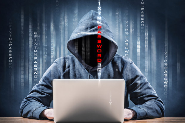 Hacker behind computer- Edem Boni