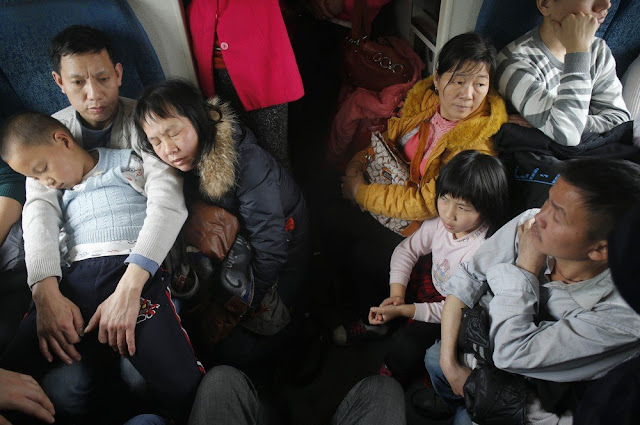 People stuffing in a train cabin