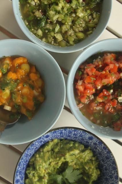 Guacamole, mango salsa, tomato salsa, and tomatillo salsa