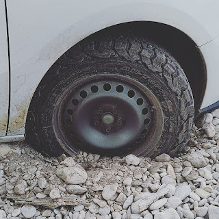 Tire stuck in gravel