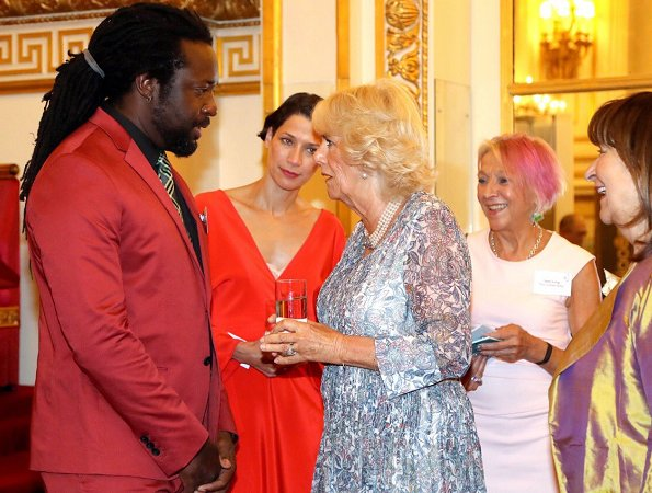 Duchess of Cornwall attended a reception at Buckingham Palace to mark the 50th Anniversary of the Man Booker Prize. Duchess wore print summer dress