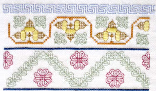 "row of Greek key design in blue, a row of acorns, a line of blue, a band of leaves in an ""m"" shape with red flowers in the triangular spaces, a row of blue"