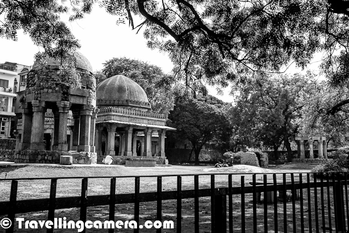 Hauz Khas Village is very different place in Delhi with lot of green area around the place, some heritage places, colorful birds around Royal Tank, a different sort of market full of art galleries, cafes & Restaurants etc. Let's have a quick PHOTO JOURNEY to Hauz Khas Village and some interesting places around it...Very first photograph shows series of corridors in one of part of the ruins of Hauz Khas Village. This place used to be Madarsa as one point of time. Now a meeting place for couples of Delhi !The ruins in middle of Hauz Khas Village Market has Tomb of Firoz Shah. Firoz Shah's Tomb is located in middle on the campus which has all the ruins including Pavilions, Mosque, Madarsa & this Tomb dedicated to Firoz Shah, his two sons and a Grandson. Above Photograph shows the only door to this Tomb which has not been repaired for a long time. There are some lush green lawns around this Tomb...Spot-billed ducks in Royal Tank of Hauz Khas Village. There is a beautiful lake near Deer Park of Green Park, Delhi and lot of colorful birds can be seen around the lake. The Spot-billed Duck is also known as the Spotbill, is a dabbling duck which breeds in tropical and eastern Asia. It has three subspecies: the Indian Spot-billed Duck , Eastern Spot-billed Duck and Burmese Spot-billed Duck. Spot Billed duck is resident in the southern part of its range from Pakistan and India to southern Japan, but the northern subspecies, the Eastern Spot-billed Duck is migratory, wintering in Southeast Asia. It is quite gregarious outside the breeding season and forms small flocks.Here is a lake of Hauz Khas Village overlooking ruins near to the market. This Photograph has been shot from Deer Park in Green Park, Delhi. 10 to 15 Black kites were roaming around the place and some of them were trying to attach ducks in the lake.Here is first view of the ruins in Hauz Khas Village, Delhi. The entry into the campus of ruins is near to Yeti Restaurant and towards the end of Hauz Khas Village market. There are three pavilions in the front lawn and mainly popular among local folks who spend their time in playing cards in this region. Of course, the place just in front of main gate can't be good for couples.Another Spot billed duck in Hauz Khas Village Lake, who calling other ducks as she has some fear from Black Kites flying on top of the lake. The Eastern Spot-billed Duck is darker and browner and it's body plumage is more similar to the Pacific Black Duck. It lacks the red bill spot and has a blue speculum. It is a bird of freshwater lakes and marshes in fairly open country and feeds by dabbling for plant food mainly in the evening or at night. It nests on the ground in vegetation near water and lays 8-14 eggs. Both the male and female have calls similar to the Mallard.A curious duck on lakeside @ Deer Park, Hauz Khas Village, Green Park, Delhi, IndiaMore photographs from Hauz Khas Village can be seen at http://phototravelings.blogspot.in/2012/03/firoz-shahs-tomb-at-hauz-khas-village.html
