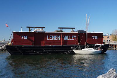Red historic barge with Leigh Valley and the number 79 painted in white on the side